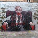 Немцы на граффити Путина написали «вор» и «убийца»