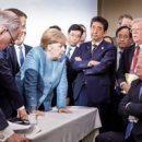 «Не говори, что ничего тебе не даю»: Трамп бросил в сторону Меркель конфеты на саммите G7