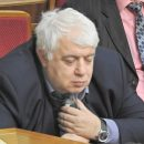 Нардеп во время заседания парламента заснул на бутылке (фотофакт)